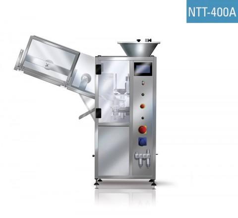 Remplisseuse automatique de tubes plastique NTT-400A pour le remplissage, la soudure, l'estampillage de la date, la découpe d'excès de plastique.